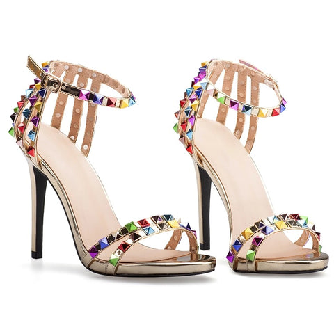 Slay Accessories. Studded gold strap high heel sandals.