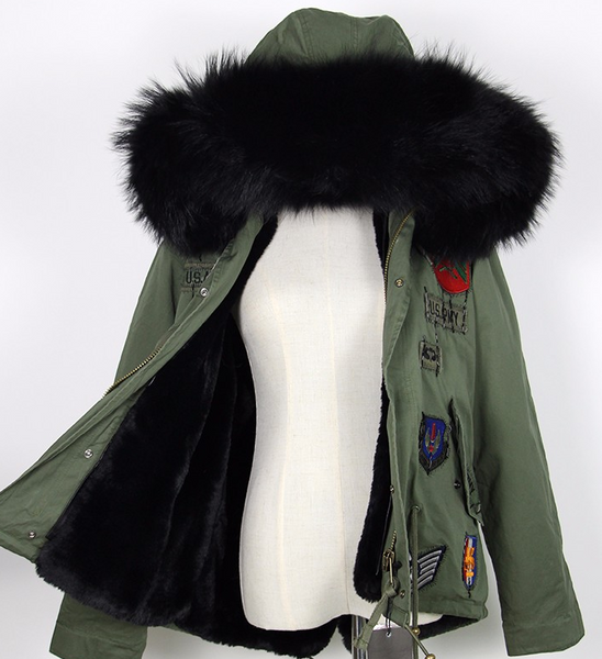 Slay Accessories. Patchwork black fur parka. Green embellished parka with black fur trim.