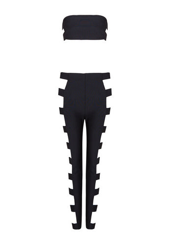 Slay Accessories.Black bandage pants set accented with gold tone metal buckles.