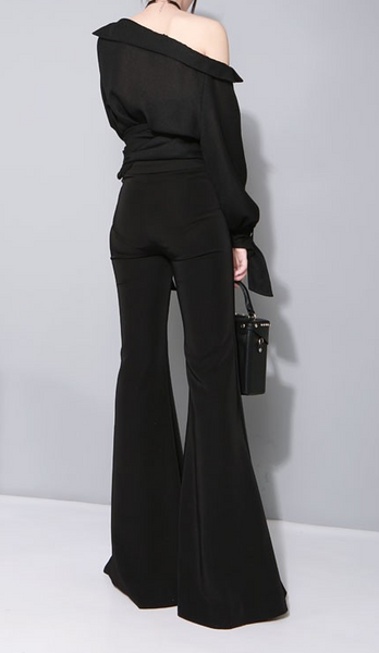 Slay Accessories. Chic black flare leg trousers. Stylish bell bottom trousers.