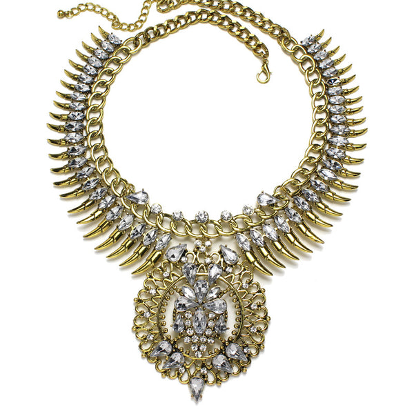 Slay Accessories. Gold crystal rhinestone chain and spike bib necklace. Gold chains and crystal statement necklace.