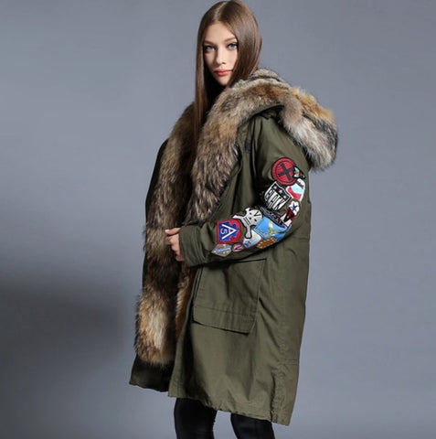 Slay Accessories. Long green parka with patchwork sleeves.