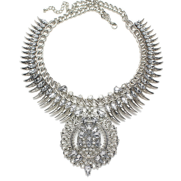 Slay Accessories. Silver crystal rhinestone chain and spike bib necklace. Silver chains and crystal statement necklace.