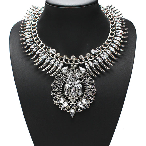 Slay Accessories. Silver crystal rhinestone chain and spike bib necklace. Silver chains and crystal statement necklace