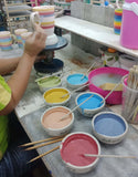 Painting mugs by hand