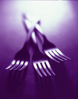 3 Forks on a purple background