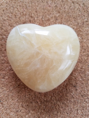 Calcite Heart Stone on cork background