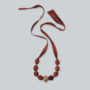 Golden brown fabric bead necklace
