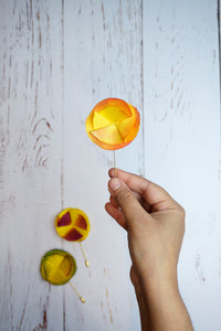 Orange silk flower pin