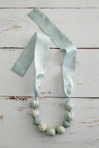 Pale blue fabric bead necklace