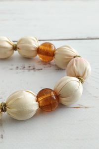 Peachy pink fabric bead necklace