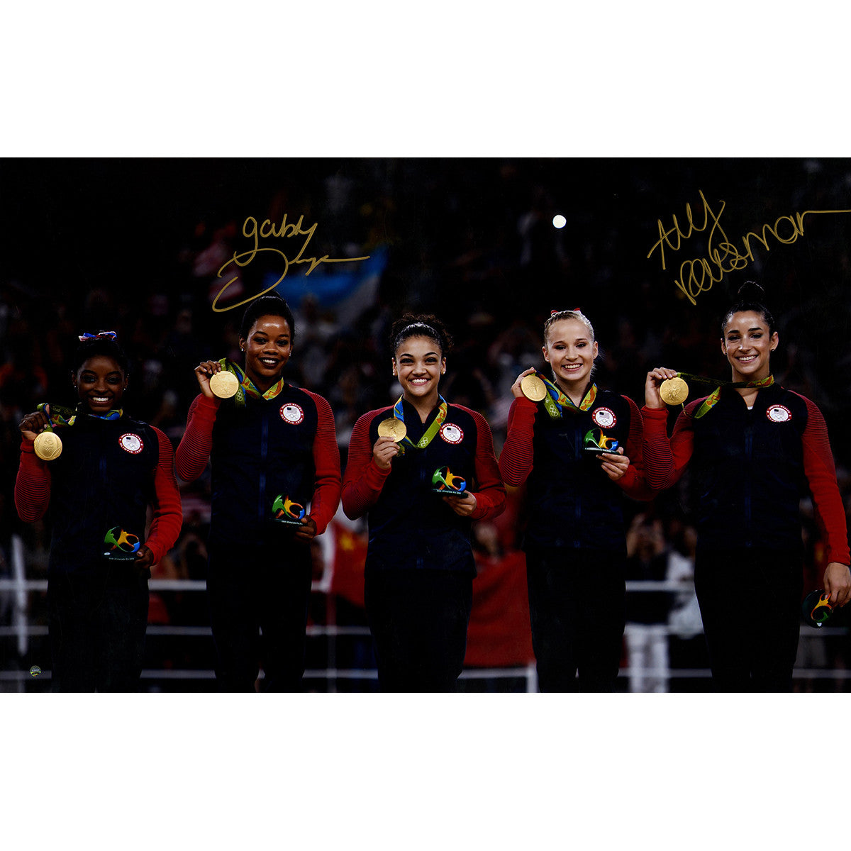 Aly Raisman/Gabby Douglas Dual Signed 2016 Medal Stand 20x32 Photo They have won a combined 6 Olympic Gold Medals and now you can add them to your collection. ̴Ì_Olympian Gymnasts Aly Raisman & Gaby Douglas have dual-signed this 20x32 picture of them standing with their 2016 USA Olympic team after capturing the Go