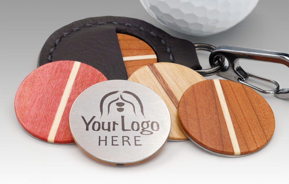 Custom laser-engraved wood golf ball marker in cherry maple pink ivory wood