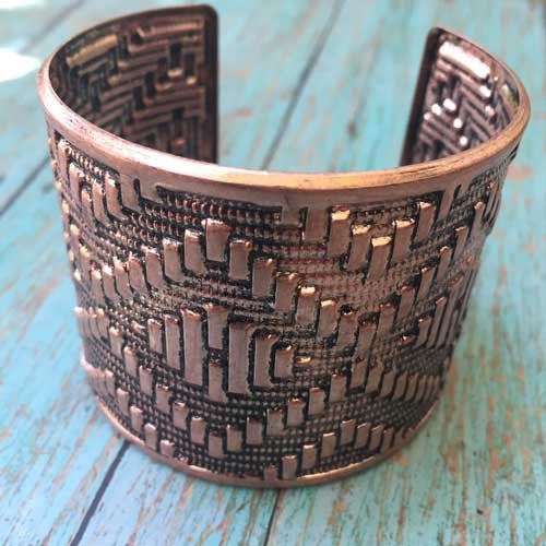 Native copper cuff with a diamond weave pattern.