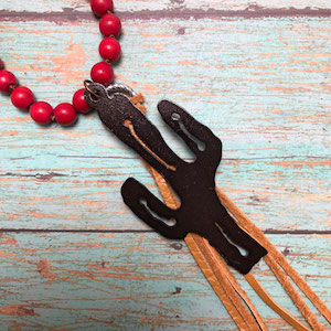 Western cactus necklace with brown fringe on red beads.