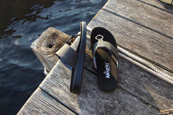 Lanie black thong sandal on comfort flat outsole