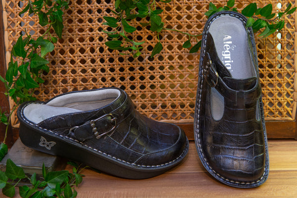 Comfy with luxurious embossed leather looks the Croco Noche Seville clog is available in the Fall/Winter 2020 collection