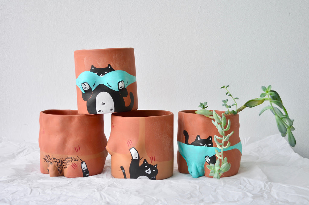 Handpainted terracotta pots | Ly Yeow