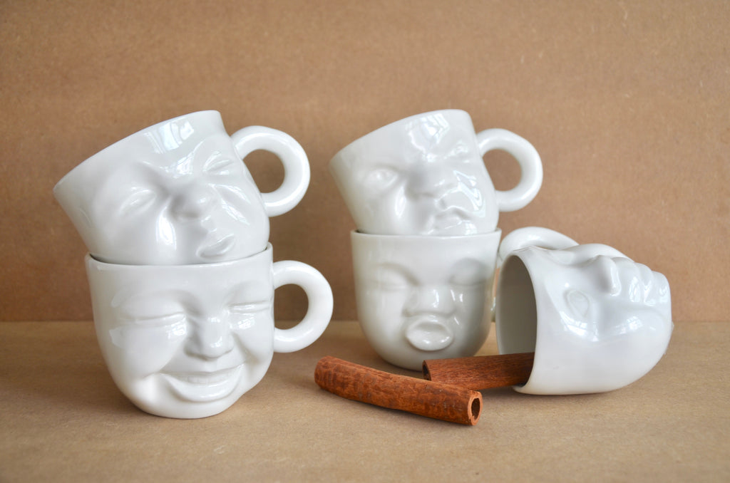 Handcrafted faces mugs | Singapore ceramics