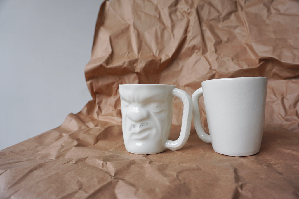 Ceramic handmade grumpy face mugs in Singapore