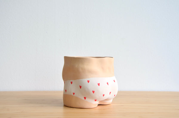 Group Partner Young Love boy planters in Singapore - handmade pot