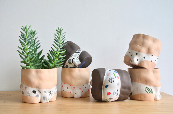 Group Partner boy male planters in Singapore - handmade ceramic pot