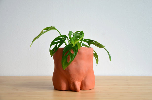 Group Partner terracotta boy planters in Singapore - handmade pot
