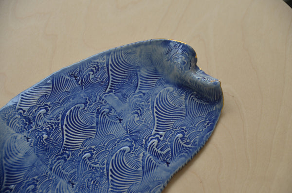 Ceramic handmade wave plates by Amelia Kingston stocked in Singapore