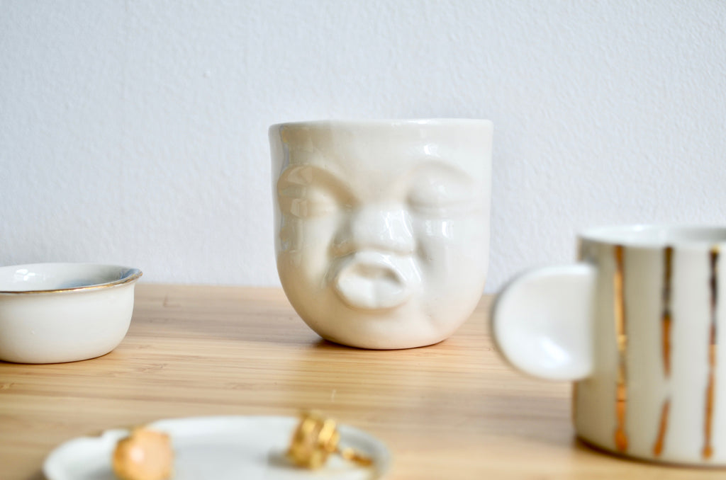 Handcrafted porcelain sculpture mugs in Singapore