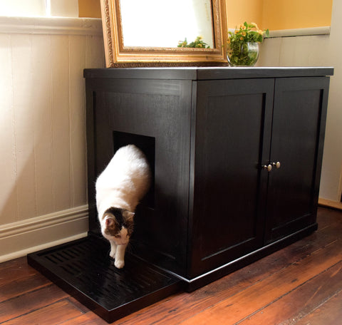 Modern Cat Litter Box hidden on a table - Clever and Modern gadgets and furniture for your home and office.