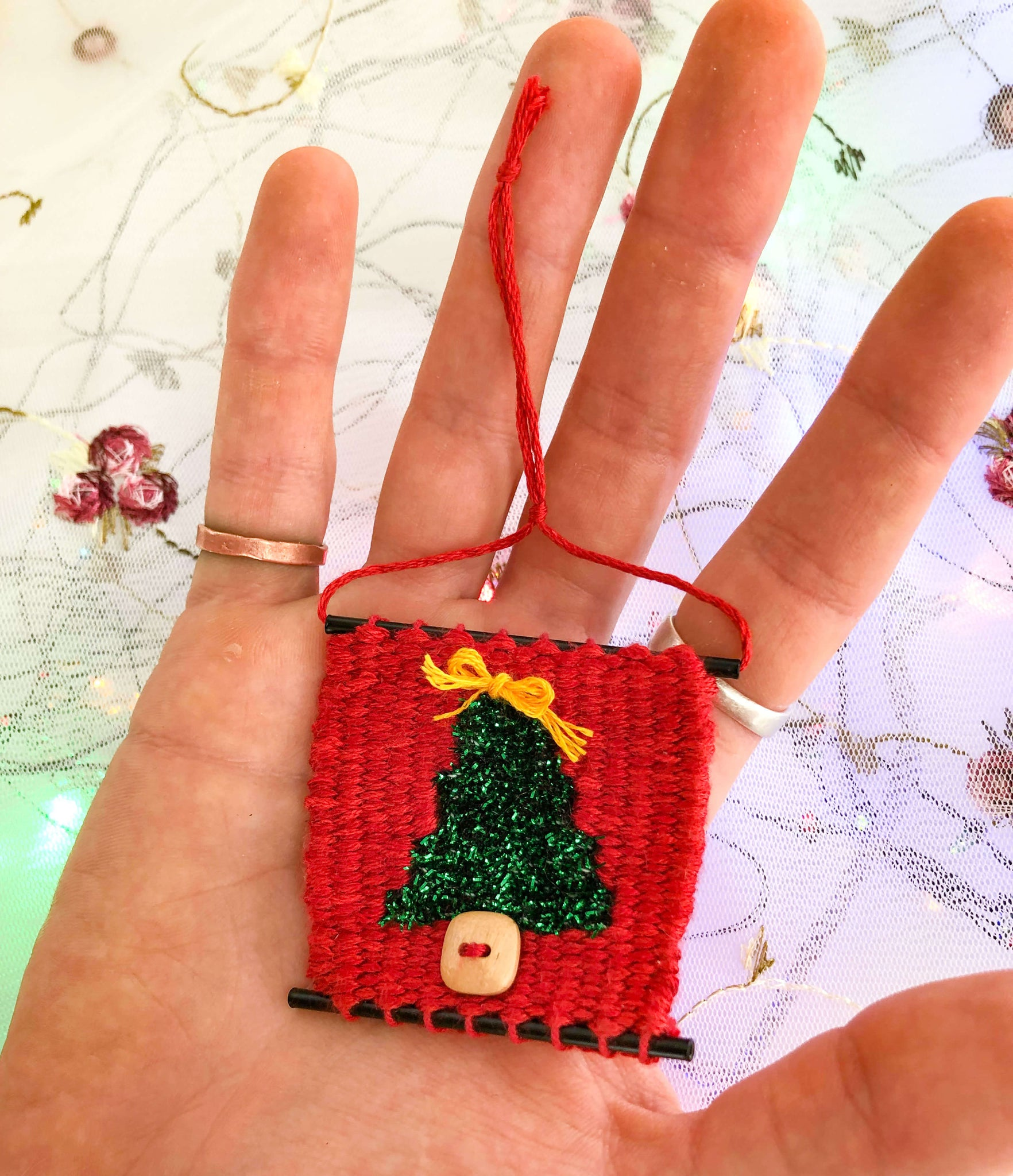 Handwoven Christmas Tree Ornament in hand