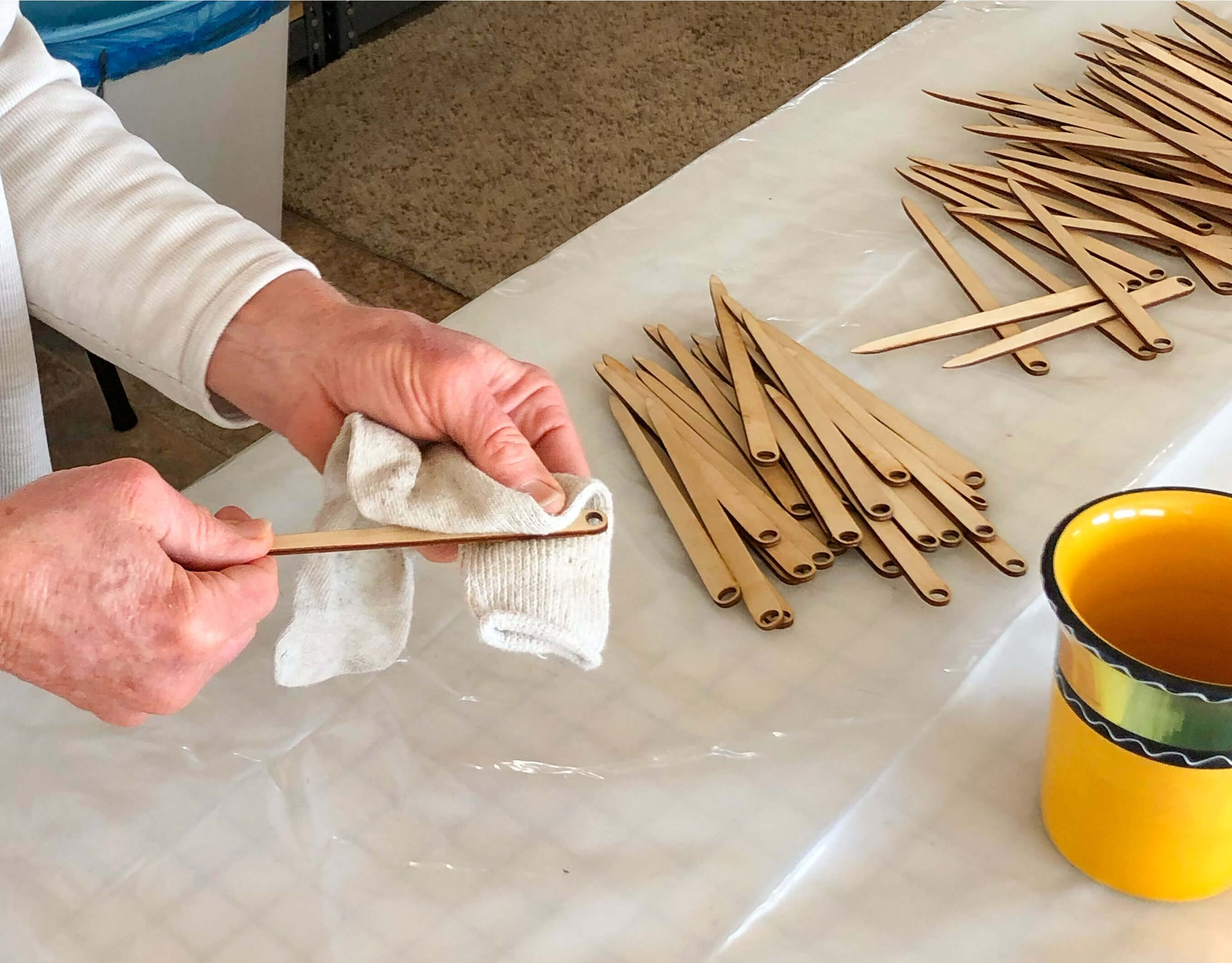 waxing the wooden needles