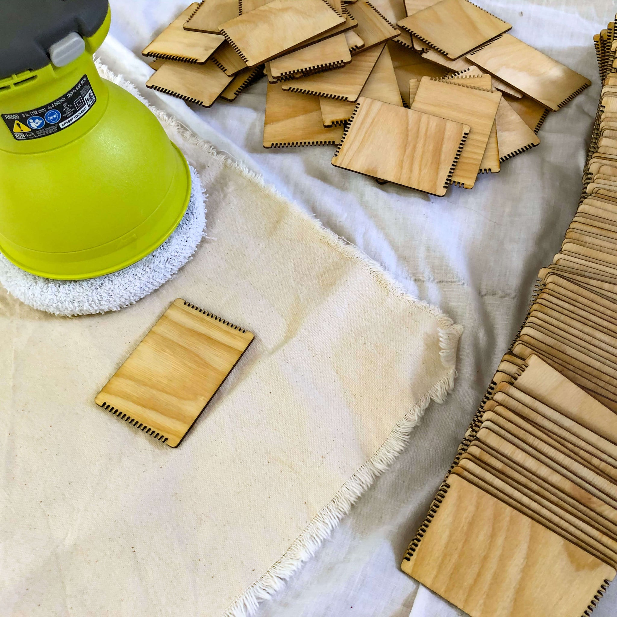 buffing the wooden looms