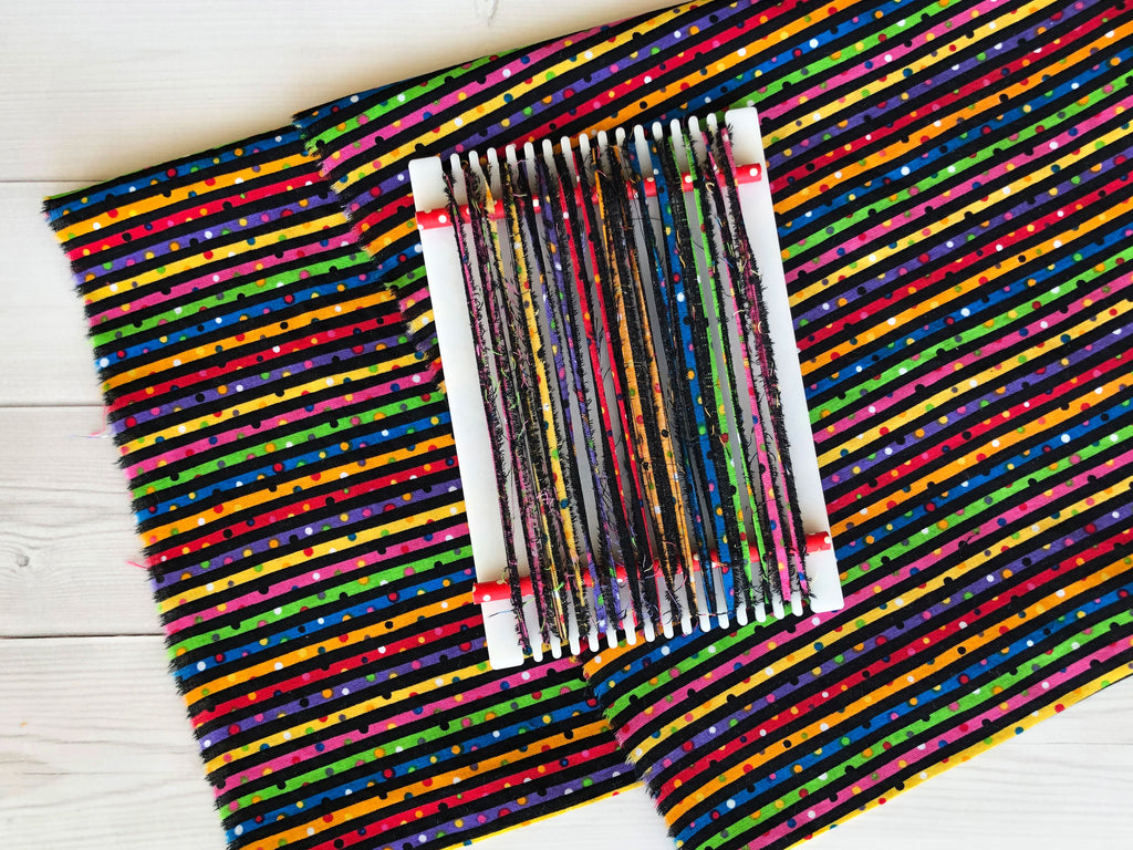 Weaving with Fabric Strips- lom on striped fabric