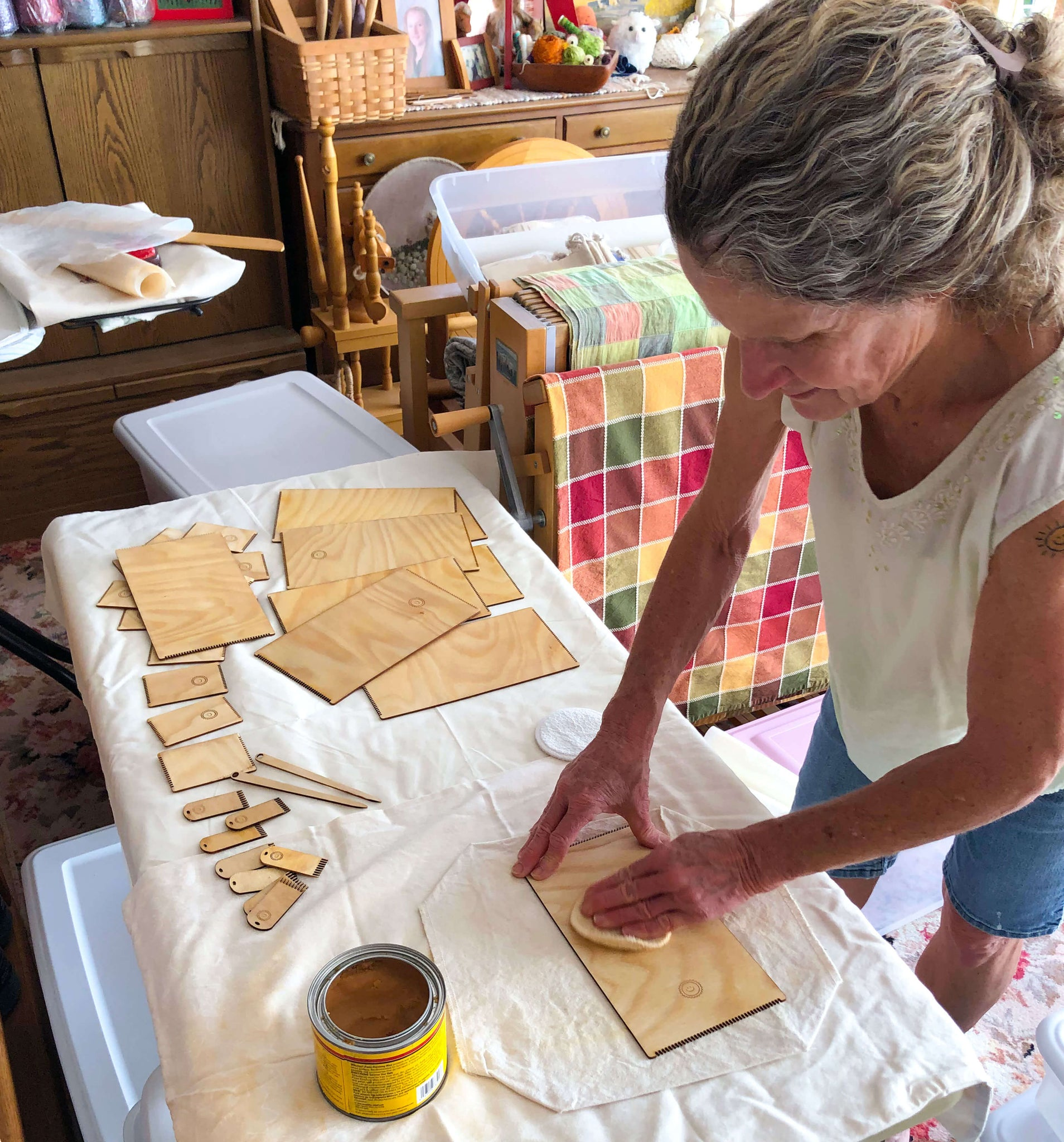 waxing the wooden looms