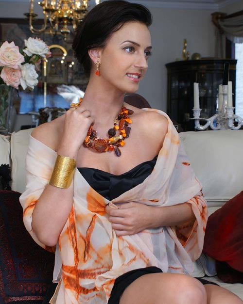 Model Apryl Orr wears 14K Gold Fleur-de-lis earrings set with Carnelian from the Nob Hill Collection by San Francisco jewelry designer John S Brana