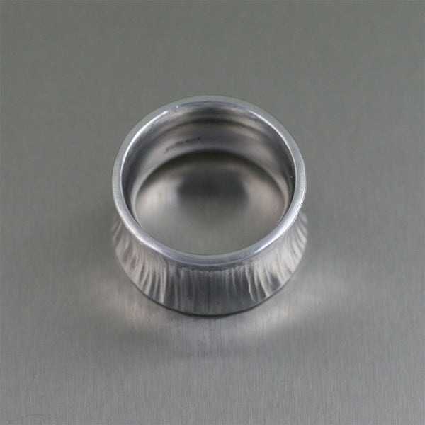 Chased Anticlastic Aluminum Band Ring – Laying Flat