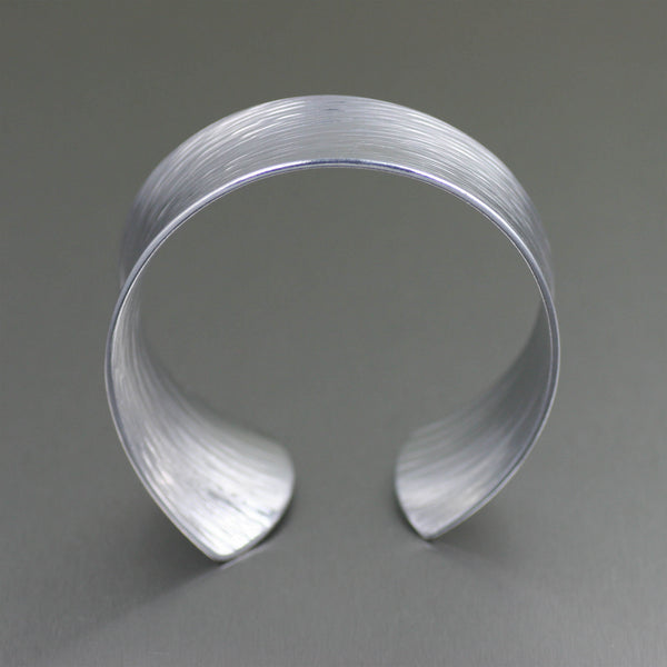 Tapered Bark Anticlastic Aluminum Bangle Bracelet – Front View