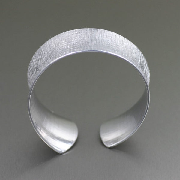 Tapered Linen Anticlastic Aluminum Bangle Bracelet – Front View