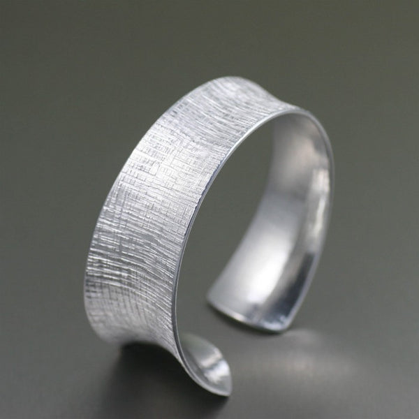 Tapered Linen Anticlastic Aluminum Bangle Bracelet – Left Side View