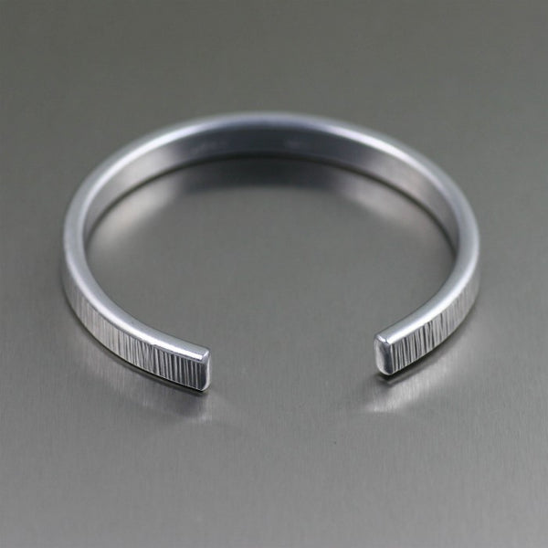 Thin Chased Aluminum Cuff Bracelet – Laying Flat View