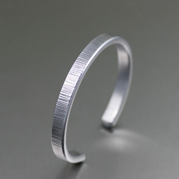 Thin Chased Aluminum Cuff Bracelet – Left View