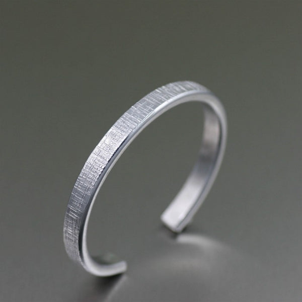 Thin Linen Aluminum Cuff Bracelet – Left Side View
