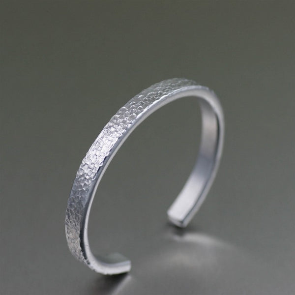 Thin Texturized Aluminum Cuff Bracelet – Left Side View