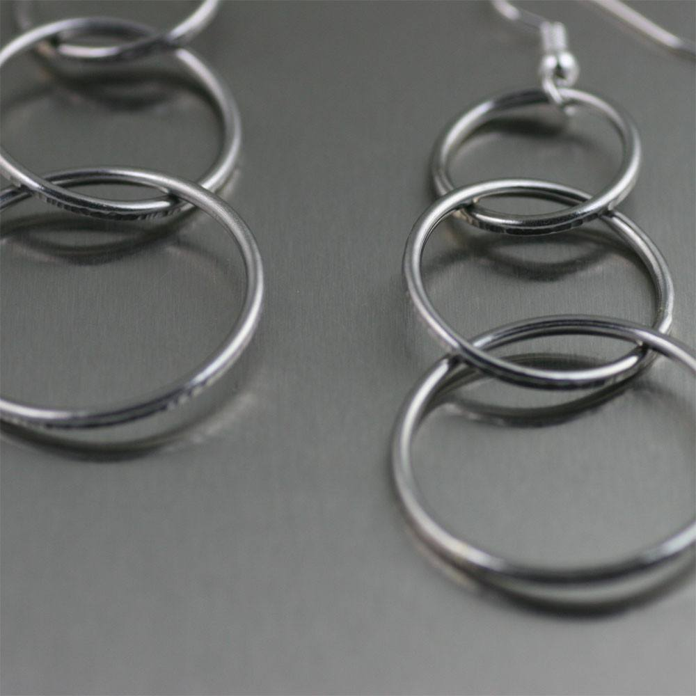 Chased Rim Stainless Steel Three Tiered Chandelier Earrings - johnsbrana - 2
