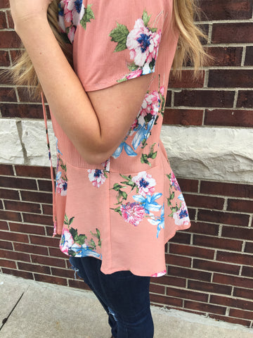 Floral peach colored lace up front detail with flared waist