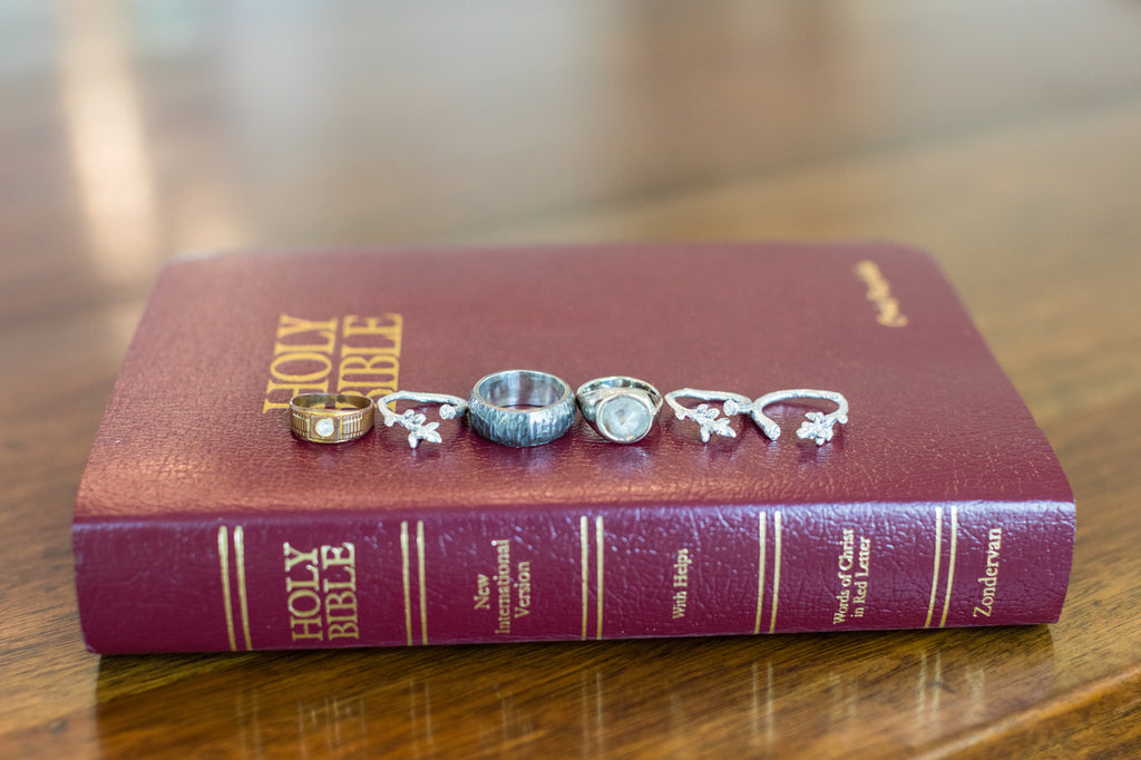 Blended family wedding rings on top of bible