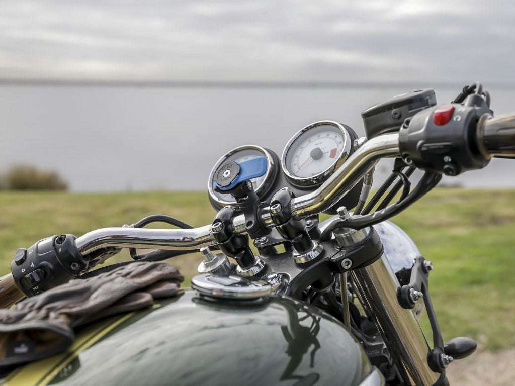 pov of rider looking at quad lock handlebar mount on triumph handlebars