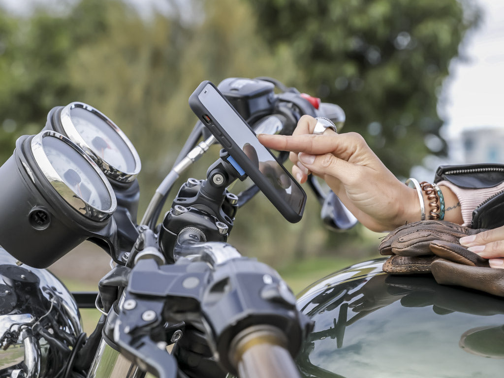 using iphone attached to triumph motorbike quad lock handlebar mount and moto knuckle adaptor