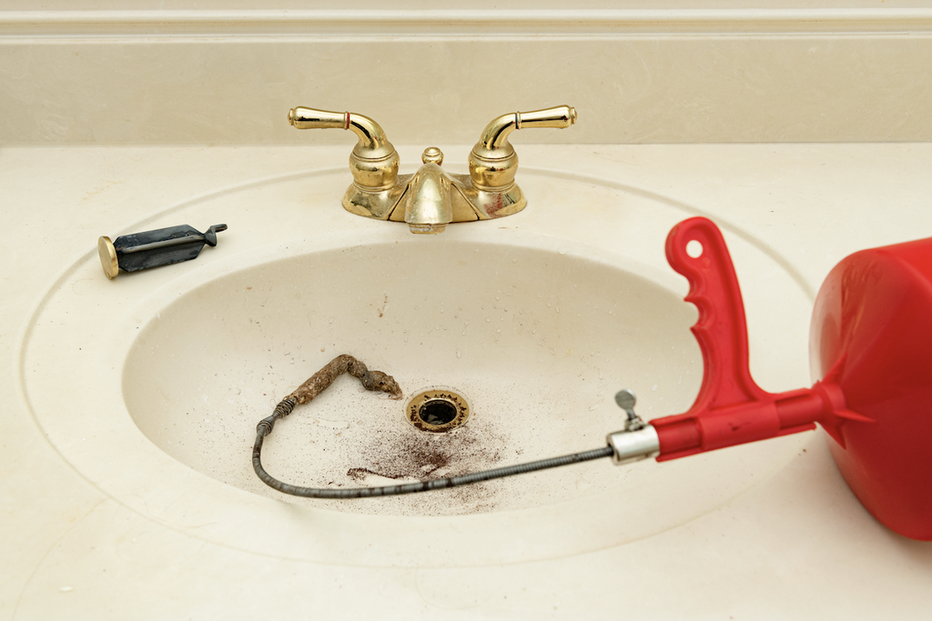 how to get hair out of drain: Hair taken out of a drain using a plumbing snake